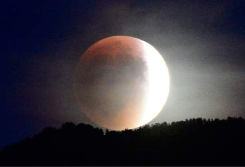 "Scott Sommerdorf   |  The Salt Lake Tribune The ""Blood Moon"" eclipse as seem from Millcreek, Sunday, September 26, 2015."