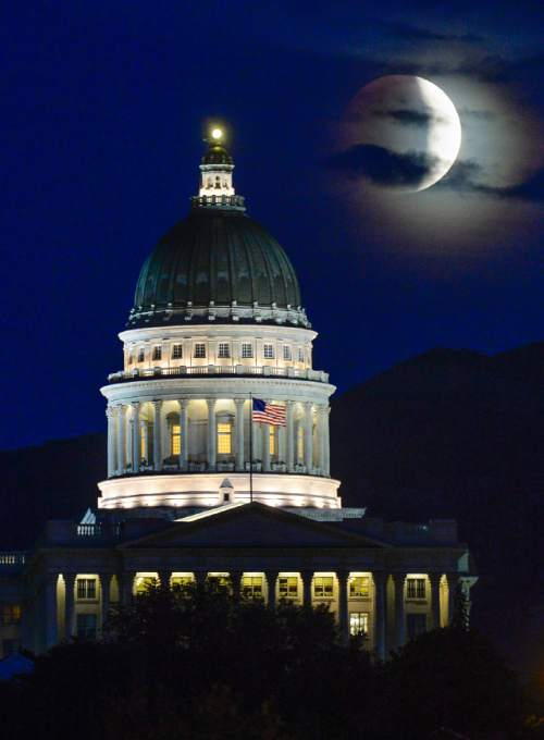 Francisco Kjolseth | The Salt Lake Tribune A rare super moon lunar eclipse, begins its transformation behind the Utah State Capitol in Salt Lake City on Sunday, Sept. 27, 2015.