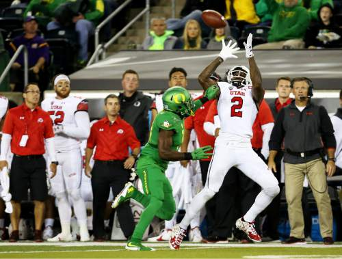 Utah wide receiver Kenneth Scott (2) catches the ball during the second half of an NCAA college football game against Oregon, Saturday, Sept. 26, 2015, in Eugene, Ore. (AP Photo/Ryan Kang)