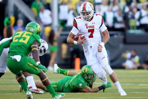 Utah quarterback Travis Wilson (7) runs with the ball during the first half of an NCAA college football game against Oregon, Saturday, Sept. 26, 2015, in Eugene, Ore. (AP Photo/Ryan Kang)