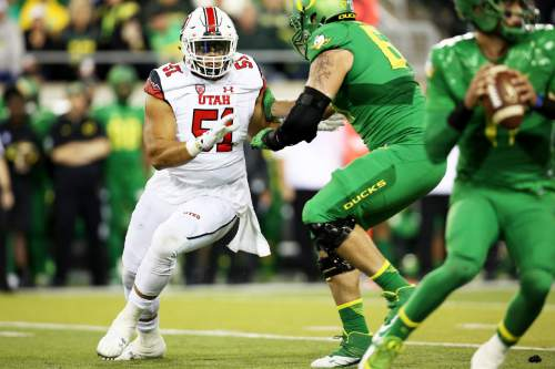 Utah defensive end Jason Fanaika (51) looks to get around the Oregon offensive line during the second half of an NCAA college football game, Saturday, Sept. 26, 2015, in Eugene, Ore. (AP Photo/Ryan Kang)