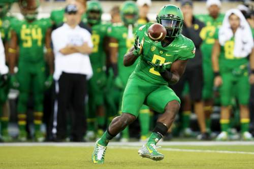 Oregon wide receiver Byron Marshall (9) catches the football during the first half of an NCAA college football game against Utah, Saturday, Sept. 26, 2015, in Eugene, Ore. (AP Photo/Ryan Kang)