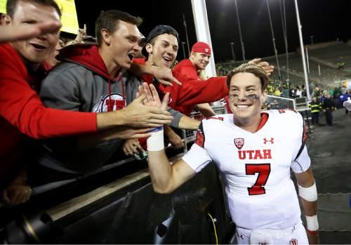 Utah quarterback Travis Wilson (7) high-fives the crowd after an NCAA college football game against Oregon, Saturday, Sept. 26, 2015, in Eugene, Ore. Utah won 62-20. (AP Photo/Ryan Kang)