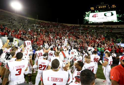 The Utah football team acknowledges the crowd after the end of an NCAA college football game against Oregon, Saturday, Sept. 26, 2015, in Eugene, Ore. Utah defeated Oregon 62-20. (AP Photo/Ryan Kang)