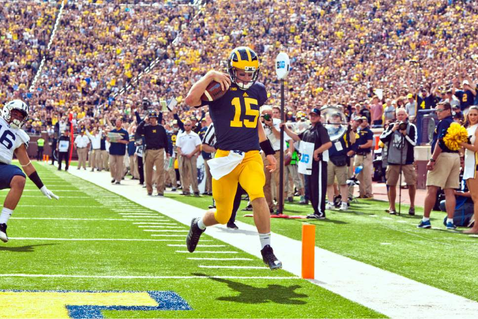 Michigan quarterback Jake Rudock (15) steps into the end zone for a touchdown in the second quarter of an NCAA college football game against BYU in Ann Arbor, Mich., Saturday, Sept. 26, 2015. (AP Photo/Tony Ding)
