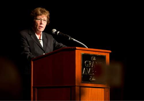 Lennie Mahler  |  The Salt Lake Tribune  Attorney Peggy Tomsic speaks upon receiving an Outstanding Achievement Award during the YWCA Leader Luncheon at the Grand America Hotel in Salt Lake City. Friday, Sept. 25, 2015.