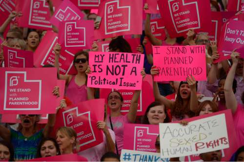 Leah Hogsten  |  The Salt Lake Tribune The Utah Capitol was covered in pink August 25, 2015 as Planned Parenthood Action Council of Utah held a community rally and proponents of the family- planning organization gathered. Governor Gary Herbert has said the money that would have gone to Planned Parenthood will be redirected to 26 health agencies in the state in 49 locations. Planned Parenthood estimates it will lose $75,000 of STD testing and more than $100,000 for educational programs.