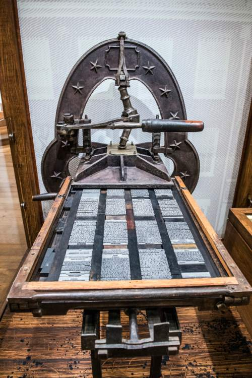 Chris Detrick  |  The Salt Lake Tribune The Smith Patented Improved printing press E.B. Grandin Company used to print the first 5,000 copies of the Book of Mormon in the LDS Church History Museum in Salt Lake City Tuesday September 29, 2015.  The LDS Church History Museum is re-opening after a year-long renovation on Wed, Sept 30.