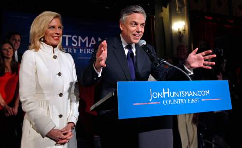 Republican presidential candidate, former Utah Gov. Jon Huntsman and his wife Mary Kaye thank supporters at a New Hampshire primary night party in Manchester, N.H., Tuesday Jan. 10, 2012. (AP Photo/Charles Krupa)