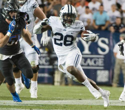 Rick Egan  |  The Salt Lake Tribune  Brigham Young running back Adam Hine (28) runs the ball for the Cougars (28) in college football action, BYU vs. Boise State at Lavell Edwards Stadium, Saturday, September 12, 2015.