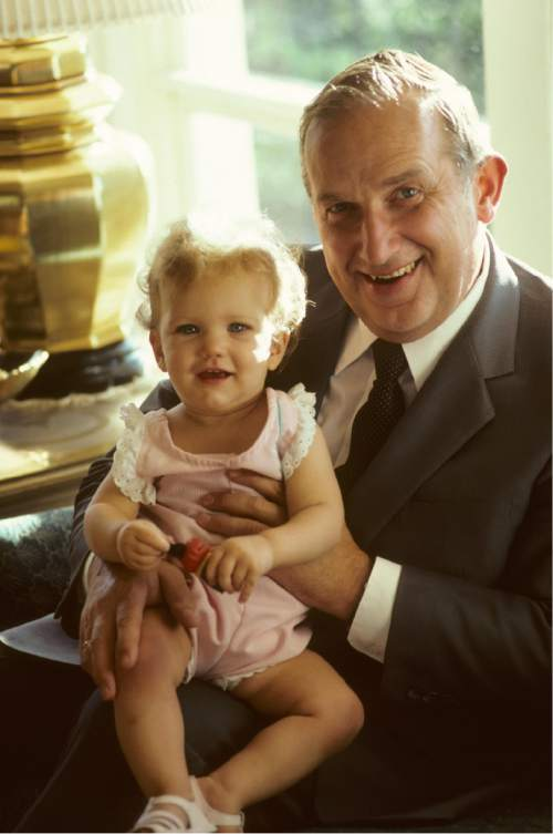 photo courtesy The Church of Jesus Christ of Latter-day Saints  Elder Richard G. Scott with his granddaughter Emily Mickle, in the early 1980s.