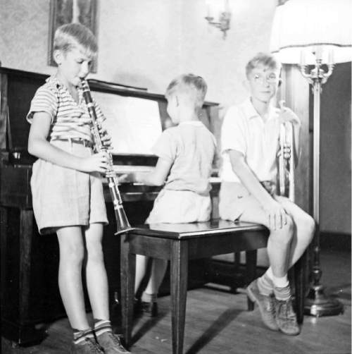 photo courtesy The Church of Jesus Christ of Latter-day Saints  Young Richard G. Scott (left) and his brothers Walt & Gerald making music.