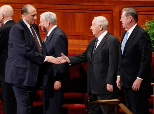 photo courtesy The Church of Jesus Christ of Latter-day Saints  President Thomas S. Monson greets Elder Richard G. Scott after a session of the April 2013 general conference of the Church.