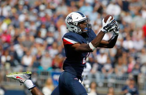 Connecticut wide receiver Tyraiq Beals (2) catches a pass for a touchdown during the second quarter of an NCAA college football game against Navy, Saturday, Sept. 26, 2015, in East Hartford, Conn. (AP Photo/Stew Milne)