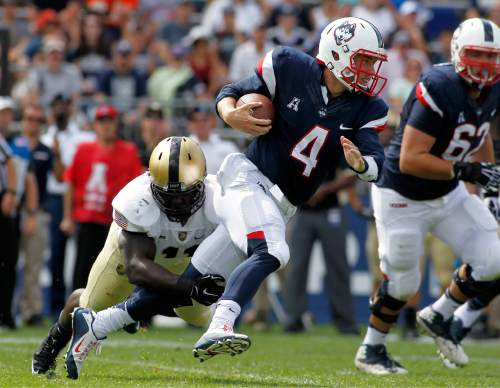 Army linebacker Andrew King (11) tackles Connecticut quarterback Bryant Shirreffs (4) during the first quarter of an NCAA college football game at Rentschler Field, Saturday, Sept. 12, 2015, in East Hartford, Conn. (AP Photo/Stew Milne)