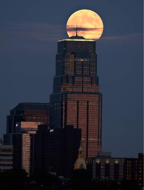 John Sleezer  |  The Associated Press The moon rises above Kansas City, Mo., in Aug. 2014, during its closest point to the earth, called perigee, as seen from Kansas City, Kan. It is often referred to as a supermoon.