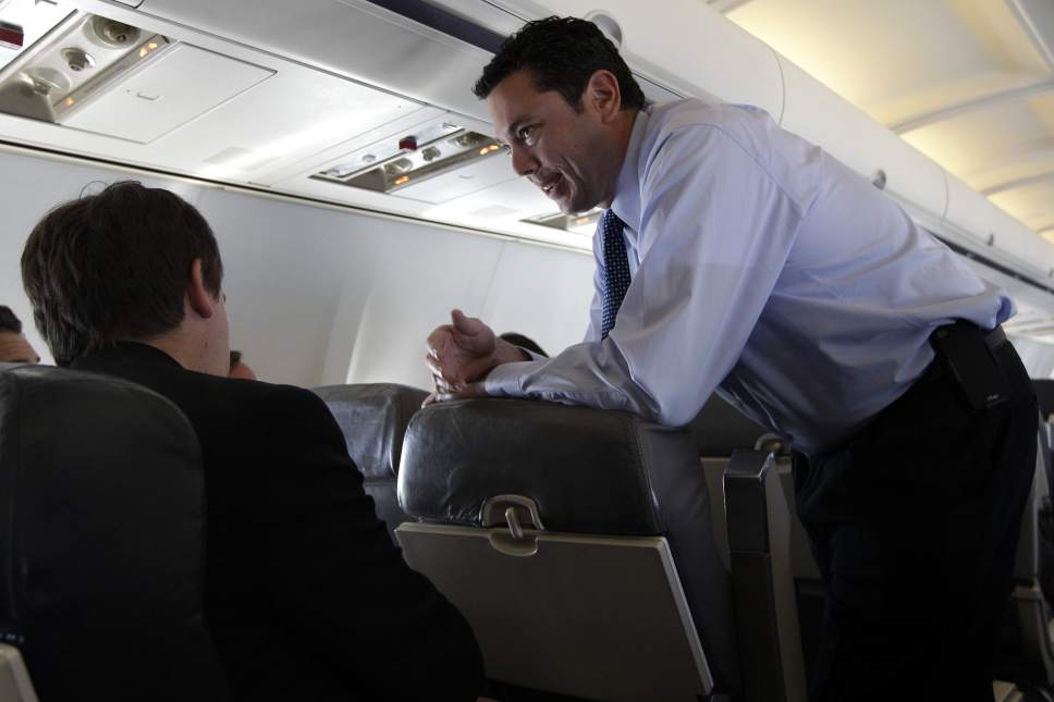 Rep. Jason Chaffetz, R-Utah, right, speaks to reporters on Republican presidential candidate, former Massachusetts Gov. Mitt Romney's campaign charter flight between Colorado and Las Vegas, Tuesday, May 29, 2012.  (AP Photo/Mary Altaffer)