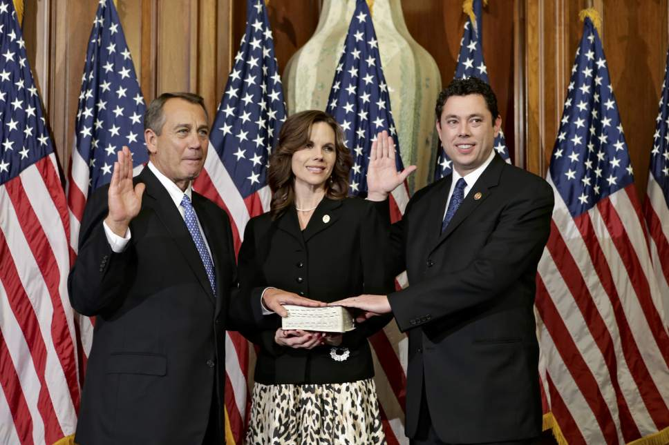 Rep. Jason Chaffetz, R-Utah, right, joined by his wife Julie, center, stands for a ceremonial photo with Speaker of the House John Boehner, R-Ohio, left, in the Rayburn Room of the Capitol after the new 113th Congress convened on Thursday, Jan. 3, 2013, in Washington. The official oath of office for all members of the House was administered earlier in the House chamber.  (AP Photo/J. Scott Applewhite)