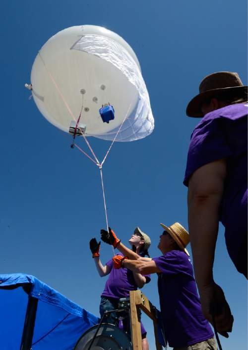 Scott Sommerdorf   |  The Salt Lake Tribune Murielle Shallbetter, center, and Bill Dowell, second from right, help bring in the weather balloon after a series of test were made, Thursday, July 16, 2015. WSU and the U are conducting a joint study on the impact of the Great Salt Lake on ozone levels on the Wasatch Front. Previous studies have found that salt from the Great Salt Lake contributes to a lot of our wintertime PM 2.5 pollution. The theory is that maybe the lake also contributes to ozone.
