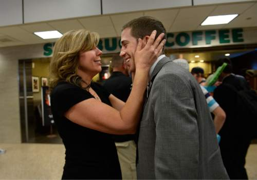Scott Sommerdorf   |  The Salt Lake Tribune Sheri Randolph welcomes home her son Tyler who has just returned from his mission to Peru at the Salt Lake International Airport, Wednesday, September 9, 2015.