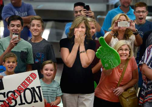 Scott Sommerdorf   |  The Salt Lake Tribune Tyler Randolph's mother, Sheri, center, cannot contain herself as she and the rest of the Randolph family get a first glimpse of him as he comes down the escalator at the Salt Lake International Airport, Wednesday, September 9, 2015.