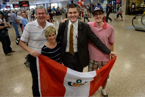 Scott Sommerdorf   |  The Salt Lake Tribune The Haacke family, Blaine, father, Anne, mother, and brother, Chris, far right, pose for a photo with Ben Haacke who has just returned from his Peruvian mission at the Salt Lake International Airport earlier this month.