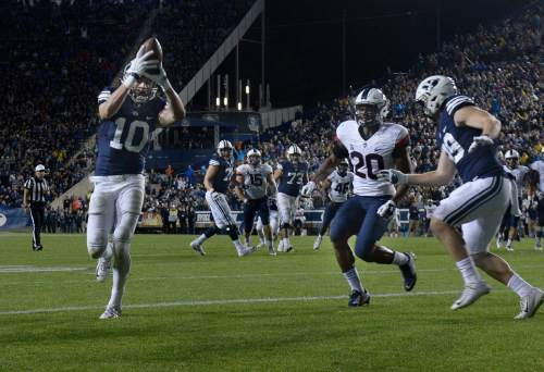 Scott Sommerdorf   |  The Salt Lake Tribune BYU wide receiver Mitch Mathews (10) scores to give BYU a 27-13 lead during second half play. BYU beat UCONN 30-13, Friday, October 2, 2015.