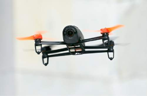 FILE - In this May 8, 2014 file photo, a Parrot Bebop drone flies during a demonstration event in San Francisco. (AP Photo/Jeff Chiu, File)