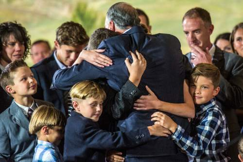 Chris Detrick     The Salt Lake Tribune Ronald A. Rasband embraces members of his family after a press conference at the Church Office Building Saturday October 3, 2015.