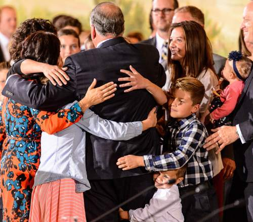 Trent Nelson  |  The Salt Lake Tribune New LDS apostle Ronald A. Rasband is embraced by family after a press conference during the 185th Semiannual General Conference of the LDS Church in Salt Lake City, Saturday October 3, 2015.