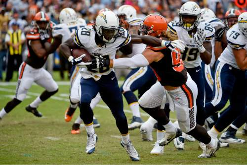 San Diego Chargers running back Melvin Gordon gets away from Cleveland Browns outside linebacker Paul Kruger, right, during the first half in an NFL football game, Sunday, Oct. 4, 2015, in San Diego. (AP Photo/Denis Poroy)