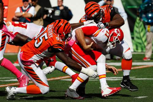 Kansas City Chiefs quarterback Alex Smith (11) is sacked by Cincinnati Bengals defensive tackle Geno Atkins (97) in the second half of an NFL football game, Sunday, Oct. 4, 2015, in Cincinnati. (AP Photo/Frank Victores)