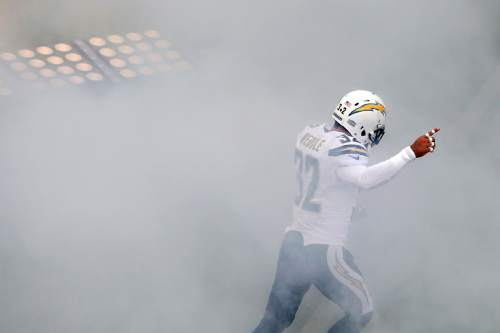San Diego Chargers free safety Eric Weddle runs onto the field during pre game ceremonies before the Chargers face the Cleveland Browns in an NFL football game, Sunday, Oct. 4, 2015, in San Diego. (AP Photo/Gregory Bull)