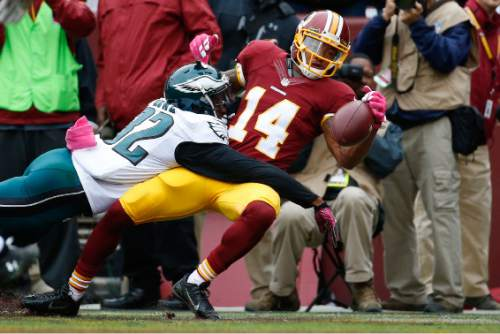 Washington Redskins wide receiver Ryan Grant (14) looses control of the ball on by Philadelphia Eagles cornerback Eric Rowe (32) during the first half of an NFL football game in Landover, Md., Sunday, Oct. 4, 2015. (AP Photo/Alex Brandon)