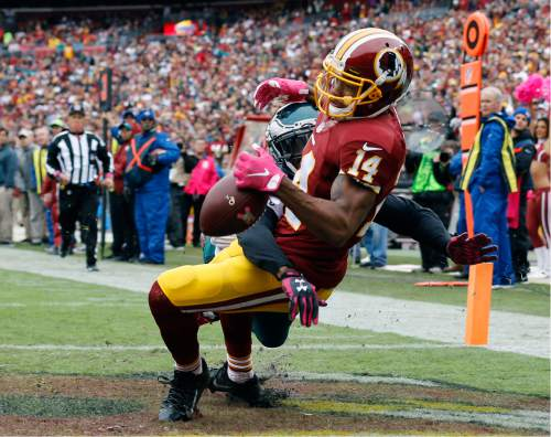 Washington Redskins wide receiver Ryan Grant (14) drops a pass in the end zone as he is covered by Philadelphia Eagles cornerback Eric Rowe during the first half of an NFL football game in Landover, Md., Sunday, Oct. 4, 2015. (AP Photo/Patrick Semansky)