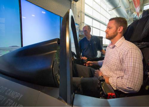 Rick Egan  |  The Salt Lake Tribune   University of Utah Mechanical Engineering student, Joe Leeman, sits in the cockpit of the F-35 simulator.  Lockheed Martin and Hill Air Force Base teamed up to bring the F-35 interactive cockpit demonstrator to the University Of Utah Wednesday, October 7, 2015.