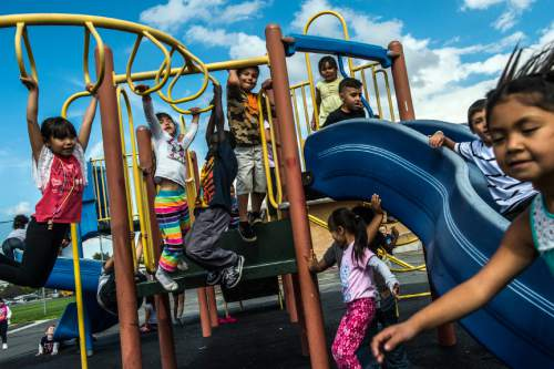 Chris Detrick  |  The Salt Lake Tribune First graders in Sydney Johnson's class play on the playground during recess at Lincoln Elementary School Tuesday October 6, 2015.