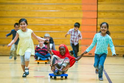 Chris Detrick  |  The Salt Lake Tribune First graders Alyani Phanthavong, Denawo Abdikadiri and Genesis Orenday Camacho play in gym class at Lincoln Elementary School Tuesday October 6, 2015.