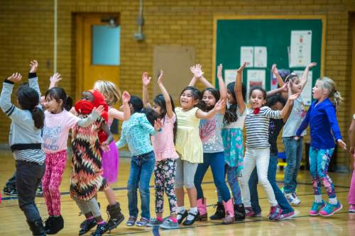 Chris Detrick  |  The Salt Lake Tribune First graders do jumping jacks in gym class at Lincoln Elementary School Tuesday October 6, 2015.