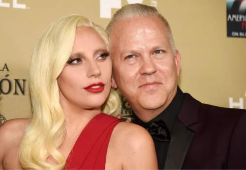 """Lady Gaga, left, and executive producer/director/writer Ryan Murphy arrive at the Los Angeles premiere screening of """"American Horror Story: Hotel"""" at Regal Cinemas L.A. Live on Saturday, Oct. 3, 2015. (Photo by Chris Pizzello/Invision/AP)"""