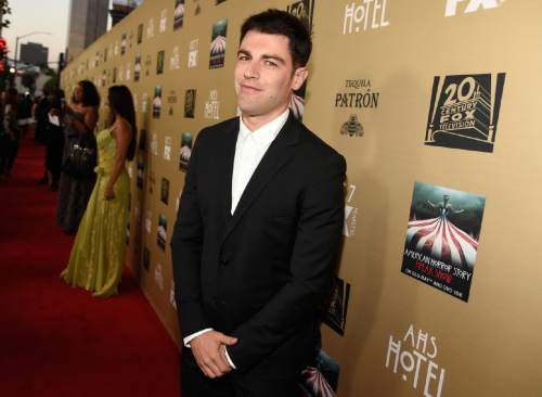 """Max Greenfield arrives at the Los Angeles premiere screening of """"American Horror Story: Hotel"""" at Regal Cinemas L.A. Live on Saturday, Oct. 3, 2015. (Photo by Chris Pizzello/Invision/AP)"""