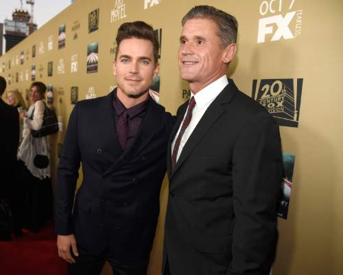 """Matt Bomer, left, and Simon Halls arrive at the Los Angeles premiere screening of """"American Horror Story: Hotel"""" at Regal Cinemas L.A. Live on Saturday, Oct. 3, 2015. (Photo by Chris Pizzello/Invision/AP)"""