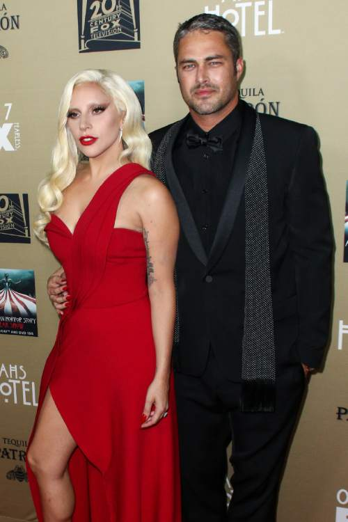"""Lady Gaga, left, and Taylor Kinney attend the LA Premiere Screening of """"American Horror Story: Hotel"""" held at Regal Cinemas L.A. Live on Saturday, Oct. 3, 2015, in Los Angeles. (Photo by John Salangsang/Invision/AP)"""