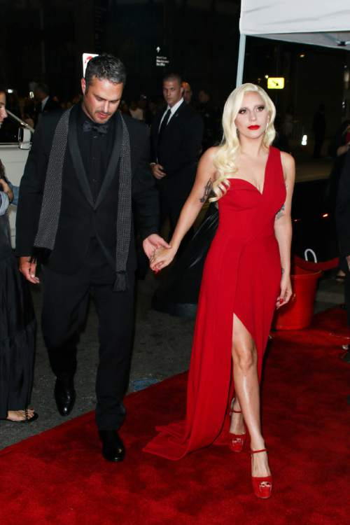 """Taylor Kinney, left, and Lady Gaga attend the LA Premiere Screening of """"American Horror Story: Hotel"""" held at Regal Cinemas L.A. Live on Saturday, Oct. 3, 2015, in Los Angeles. (Photo by John Salangsang/Invision/AP)"""