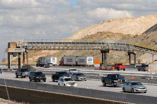 Trent Nelson  |  The Salt Lake Tribune A new conveyor belt bridge goes over northbound I-15 traffic near the Point of the Mountain, Tuesday October 6, 2015. The bridge transports concrete from the batch plant over the highway and directly into the work zone (in the middle of the freeway) as part of a two-year project to widen I-15 to six lanes in each direction from Lehi to Draper.