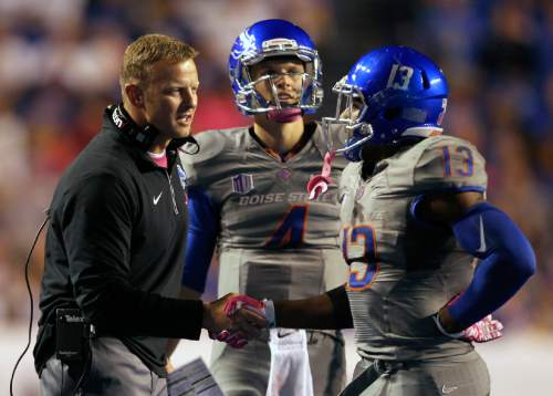 Boise State head coach Bryan Harsin talks with quarterback Brett Rypien and running back Jeremy McNichols during an NCAA college football game against Hawaii, Saturday, Oct. 3, 2015, in Boise, Idaho. (Kyle Green/Idaho Statesman via AP)  LOCAL TELEVISION OUT (KTVB 7); MANDATORY CREDIT
