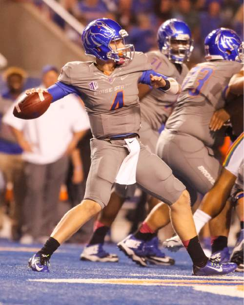 Boise State quarterback Brett Rypien (4) passes during the first half of an NCAA college football game against Hawaii in Boise, Idaho, on Saturday, Oct. 3, 2015. (AP Photo/Otto Kitsinger)