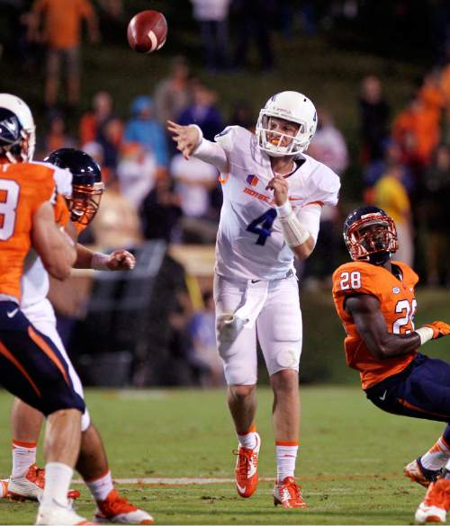 Boise State quarterback Brett Rypien throws a pass against Virginia during an NCAA college football game Friday, Sept. 25, 2015, in Charlottesville, Va. (Kyle Green/The Idaho Statesman via AP)
