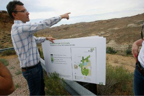 Scott Sommerdorf   |  The Salt Lake Tribune  Mining engineer Ben France gestures towards an area near the White River that shows how the strata of oil shale fits into the geology of the area, Wednesday, August 7, 2013.  The Estonian state-owned company Enefit American Oil seeks to develop Utah oil shale.