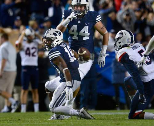 Scott Sommerdorf   |  The Salt Lake Tribune BYU defensive back Michael Shelton (18) comes up after intercepting a pass to help seal the BYU win during second half play. BYU beat UCONN 30-13, Friday, October 2, 2015.
